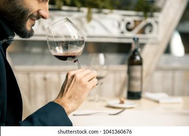 Winemaker with wine glass in restaurant