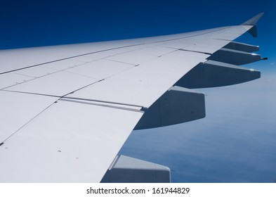 Wing of Airbus A380 in sky