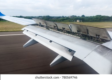 The wing of the aircraft with flaps open when landing