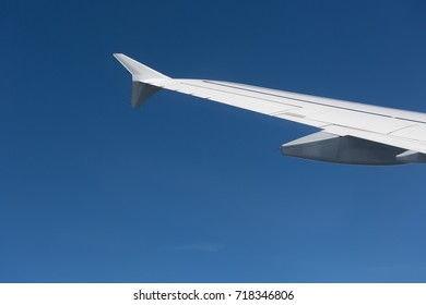 Wing of airplane in the blue sky