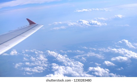 Wing airplane and cloud in the sky