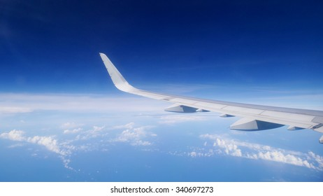 Wing of the airplane flying above a blue sky. (3)