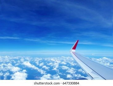 Wing of the airplane flying on the sky