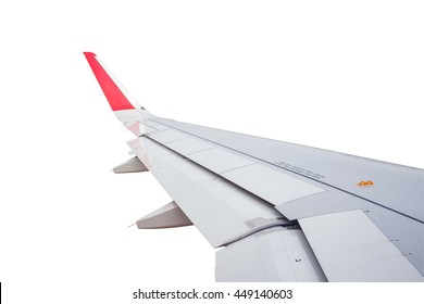 Wing of airplane flying on white background