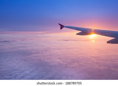 Wing of an airplane in the sunset
