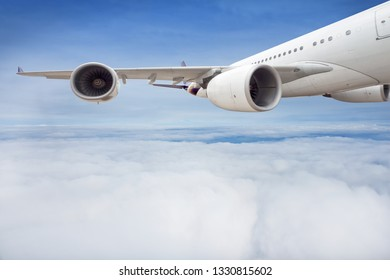 Wing and engine of passenger airplane is flying in the sky.