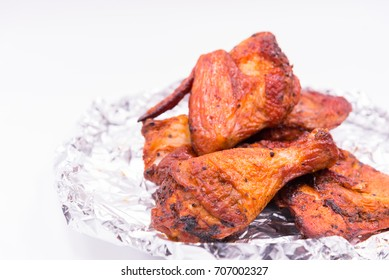 Wing, leg delicious grill chicken on foil on white background