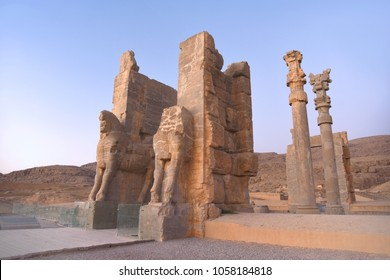 Winged bulls with shattered heads stand at the entrance to the ancient city. The main gate of Persepolis. Ancient  persian city near Shiraz. Iran.