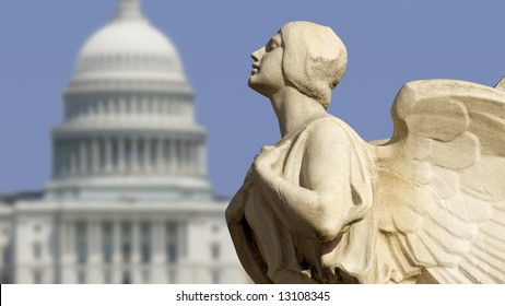 The winged figure of Democracy in front of the United States Capitol in Washington, DC.
