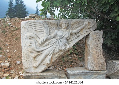 Winged Goddess Nike Marble Bas Relief, goddess of victory, along the Curetes Road in the ancient city ruins of Ephesus, Turkey near Selcuk.