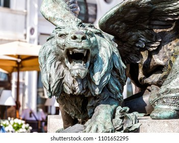 Winged lion statue architectural fragment from Venice. Detail of winged lion in flag mast on Piazza San Marco, Venice, Italy