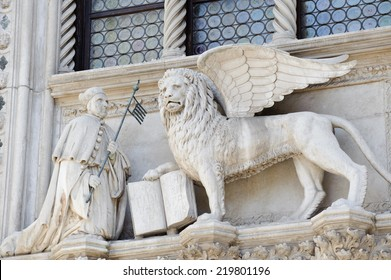 Winged lion, symbol of the city, with the Doge, on the Doge's Palace, San Marco, Venice.