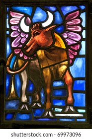 The winged ox is the evangelical symbol of St. Luke and is detail from a stained glass window from the Anglican Bermuda Cathedral built in 1866. Located in Hamilton.
