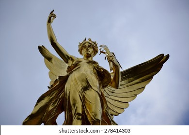 Winged victory sculpture and sky