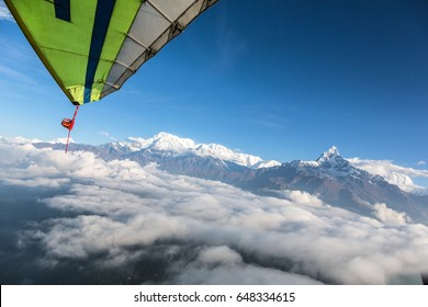 Wings from a Microlight aircraft flying along the Annapurna mountain range in the Himalayas near the city of Pokhara in Nepal.
