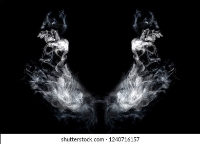 wings of smoke on an isolated black background