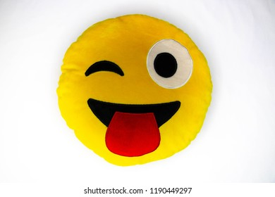 Wink Toung Out Cheeky Emoji Pillow isolated on white background. Brooklyn , NY , USA -SEptember 24, 2018