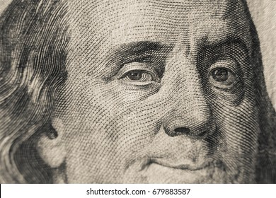 Winking Benjamin Franklin on hundred US dollars bill