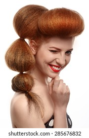 Winking girl with retro hairstyle