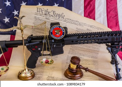 Winneconne - 11 May 2018: Bill of rights with an American flag, judges gavel and a balance scale dealing with the NRA and the second amendment