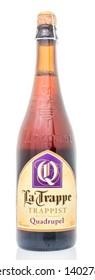 Winneconne, WI - 12 May 2019 : A bottle of La Trappe Trappist quadrupel ale with cork on an isolated background