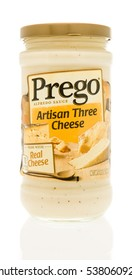 Winneconne, WI - 13 December 2016:  Jar of Prego artisan three cheese alfredo sauce on an isolated background.