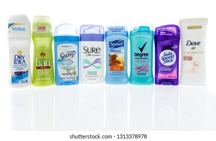 Winneconne, WI - 14 February 2019: A collection of womans deodorant including, dry idea, ban, secret, sure, suave, degree, lady speed stick and dove on an isolated background
