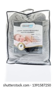 Winneconne, WI -  15 February 2019 : A package of Beautyrest luxury sherpa reversible heated blanket on an isolated background