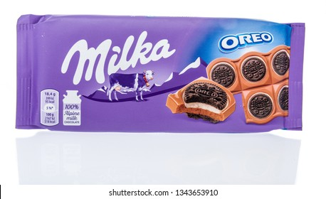 Winneconne, WI - 15 March 2019: A package of  Milka oreo sandwich surrounded by alpine milk chocolate on an isolated background