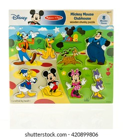 Winneconne, WI - 15 May 2016: Package of a Disney Mickey Mouse clubhouse puzzle on an isolated background