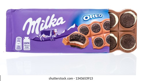 Winneconne, WI - 19 March 2019: A package of  Milka oreo sandwich surrounded by alpine milk chocolate on an isolated background