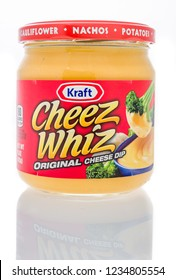 Winneconne, WI - 19 November 2018: A jar of Kraft Cheez Whiz original cheese dip on an isolated background.