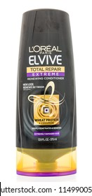 Winneconne, WI - 2 August 2018: A Bottle of Loreal Paris Elivie total repair extreme renweing conditioner on an isolated background