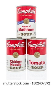 Winneconne, WI - 2 Feb 2019: A collection of Campbells soup in cream of mushroom, chicken noodle and tomato on an isolated background
