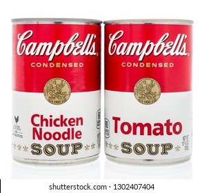 Winneconne, WI - 2 Feb 2019: A pair of can of Campbells soup in tomato and chicken noodle on an isolated background
