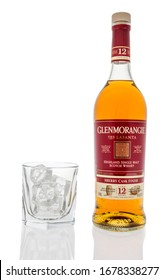 Winneconne,  WI - 20 March 2020:  A bottle of Glenmorangie Scotch whisky with glass of ice on an isolated background.
