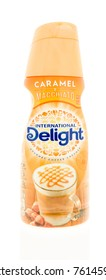 Winneconne, WI - 23 November 2017:  A bottle of International Delight coffee creamer in caramel macchito flavor on an on an isolated background.`