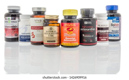 Winneconne, WI - 27 May 2019 : A collection of Astaxanthin supplements on an isolated background
