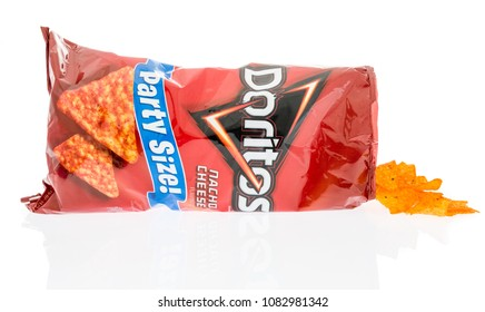 Winneconne, WI -  28 April 2018: A bag of Doritos Nacho cheese flavor chips on an isolated background.
