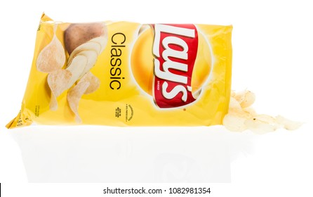 Winneconne, WI -  28 April 2018: A bag of Lays Classic potato chips on an isolated background.
