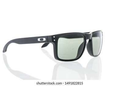 Winneconne, WI - 28 August 2019 : A shot of Oakley sunglasses by luxottica on an isolated background