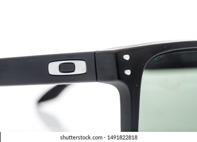 Winneconne, WI - 28 August 2019 : A close-up of Oakley sunglasses by luxottica on an isolated background