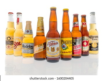 Winneconne, WI - 28 December 2019 : A collection of beer from Mexico featureing Corona, Tecate, Bohemia, Modelo, Sol, Pacifico, Estrella Jalisco, Victoria and Dos Equis beer on an isolated background