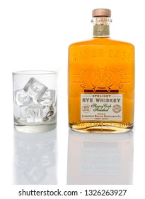 Winneconne, WI - 28 February 2019: A bottle of Limestone branch Distillery company straight rye whiskey with a glass of ice on an isolated background