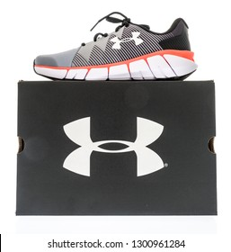 Winneconne, WI - 28 January 2019: An Under Armour shoebox with aa under armour shoe on top on an isolated background