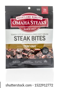 Winneconne, WI - 29 September 2019: A package of Heartland quality Omaha steaks teriyaki steak bites on an isolated background.