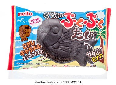 Winneconne, WI - 3 March 2019: A package of Meito puku puku tai black caramel wafers on an isolated background