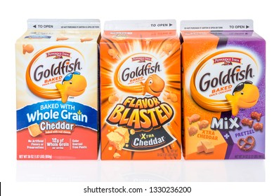 Winneconne, WI - 3 March 2019: A collection of Pepperidge Farm Goldfish baked snack crackers featuring whole grain, xtra cheddar and xtra cheddar with pretzel on an isolated background