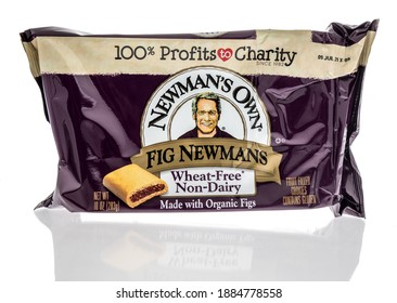 Winneconne, WI -30 December 2020: A package of  Newmans own fig cookies on an isolated background.