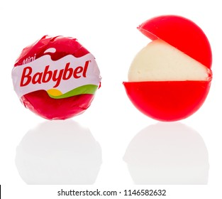 Winneconne, WI - 30 July 2018: A single Babybel semisoft cheese in original flavor on an isolated background